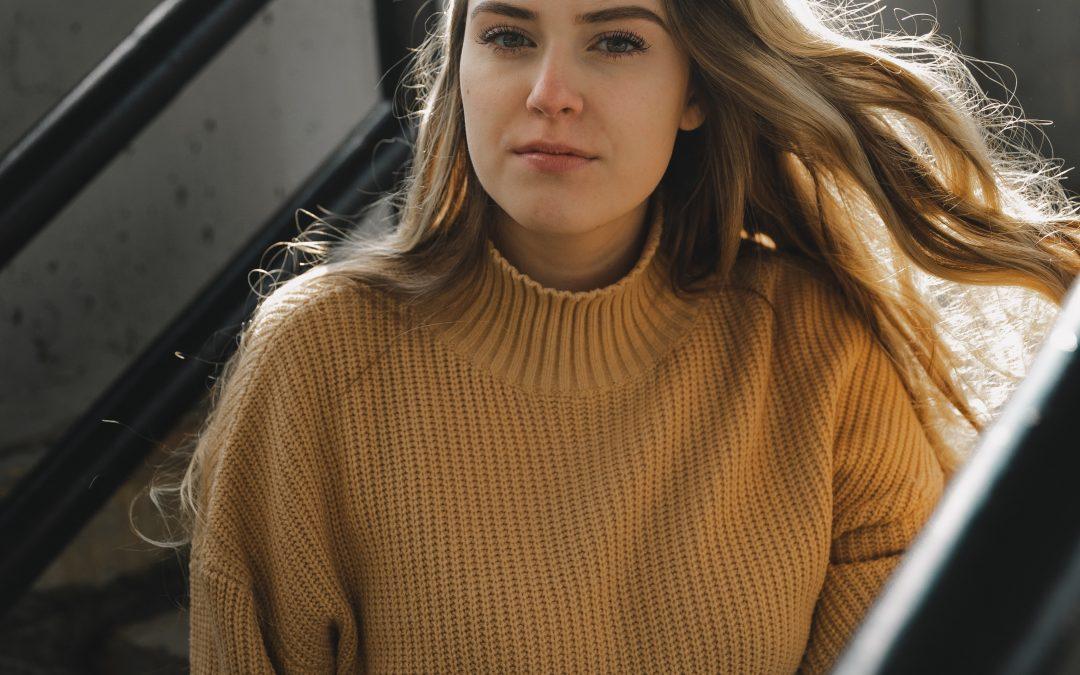 Woman in sweater sitting down